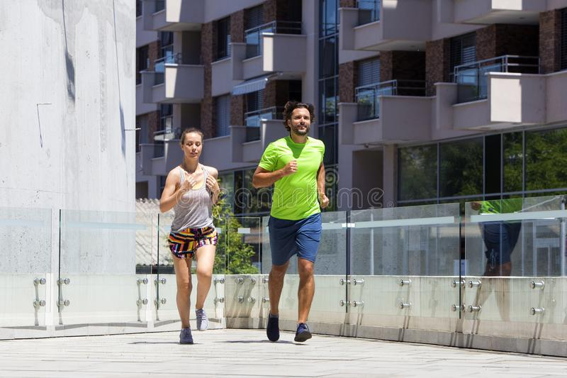 Couple Running In Urban Enviroment Stock Image - Image of ...