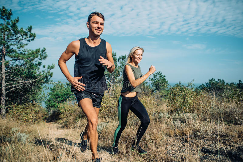 Couple running in the wood royalty free stock photo