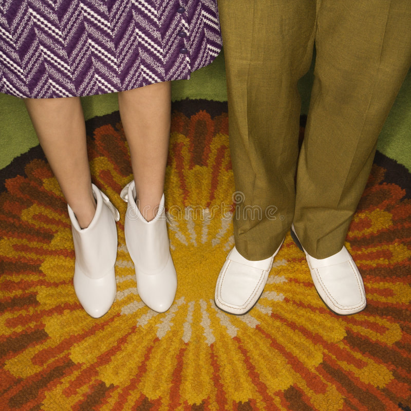 Couple's legs standing. stock photos