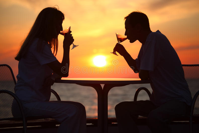 Download Couple's Silhouettes On Sunset Behind Table Stock Image - Image: 11411489