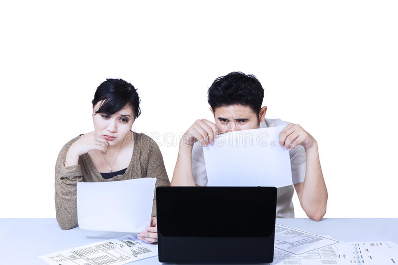 Couple Sad Looking At Laptop - Isolated Royalty Free Stock Photography