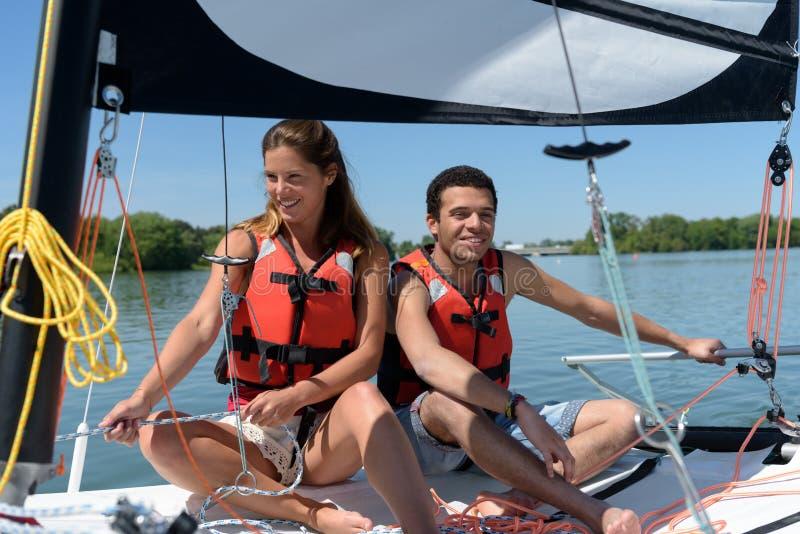 Couple on sailboat royalty free stock photo