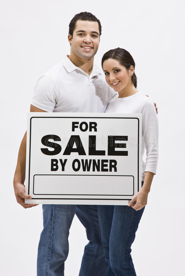Couple With For Sale By Owner Sign Royalty Free Stock Photography