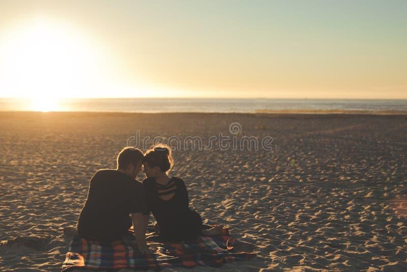 Couple On Sandy Beach At Sunset Free Public Domain Cc0 Image