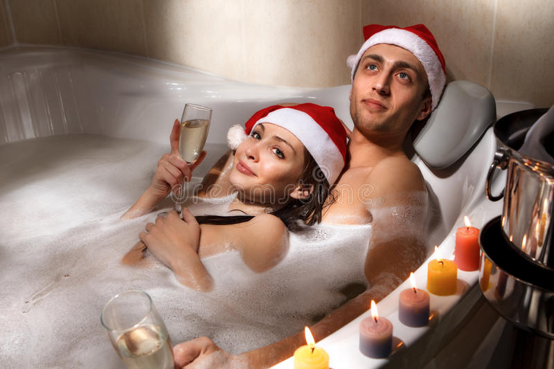 Download Couple In Santa Hats Is Enjoying A Bath Stock Photo - Image: 35270448