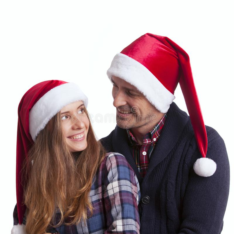 Couple in Santa hats royalty free stock image