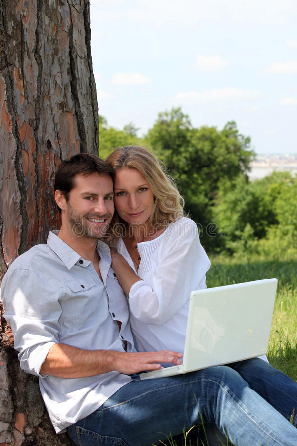 Couple Sat In Field Royalty Free Stock Images
