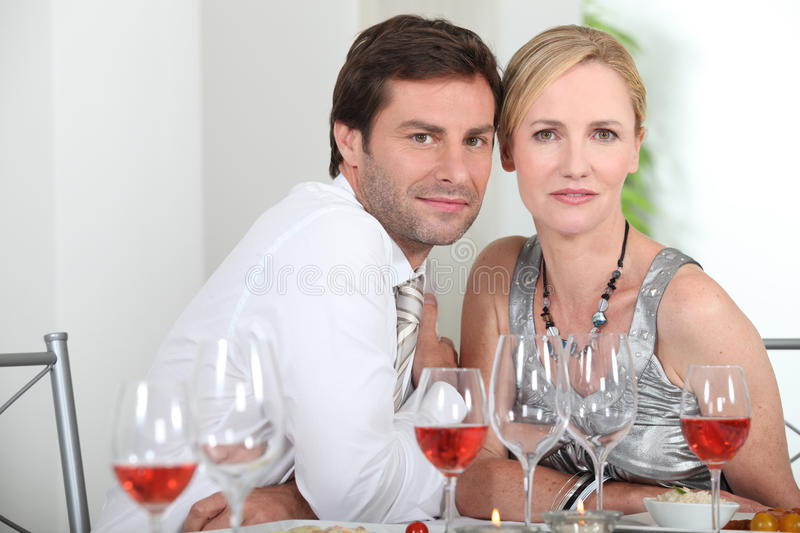 Couple sat at table royalty free stock image
