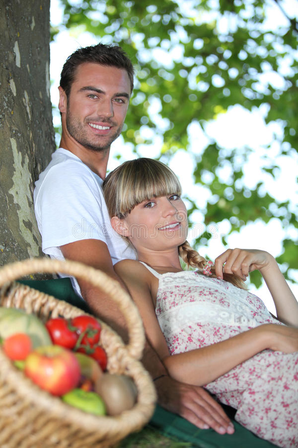 Download Couple sat by tree stock image. Image of affection, greenery - 28642639