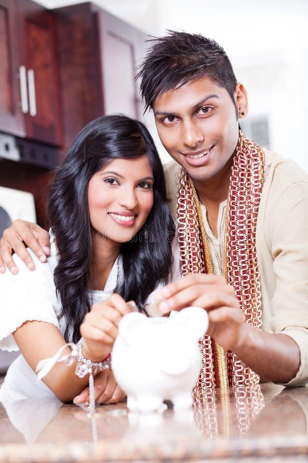 Couple saving money royalty free stock image