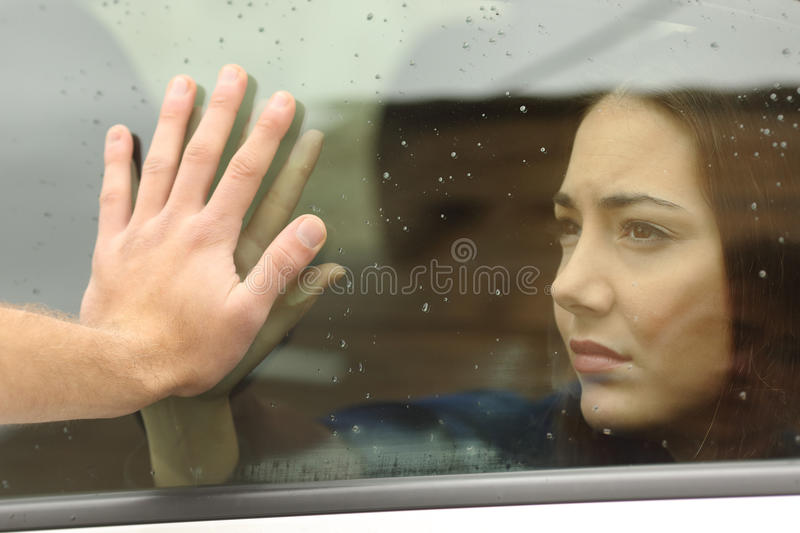 Couple saying goodbye before car travel stock photos