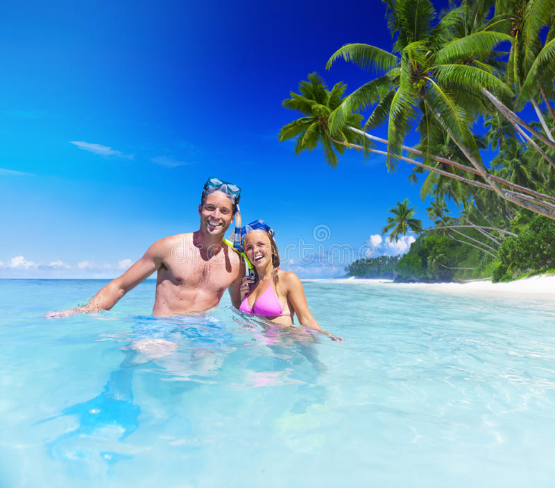 Couple with Scuba Gear in Paradise.  royalty free stock images
