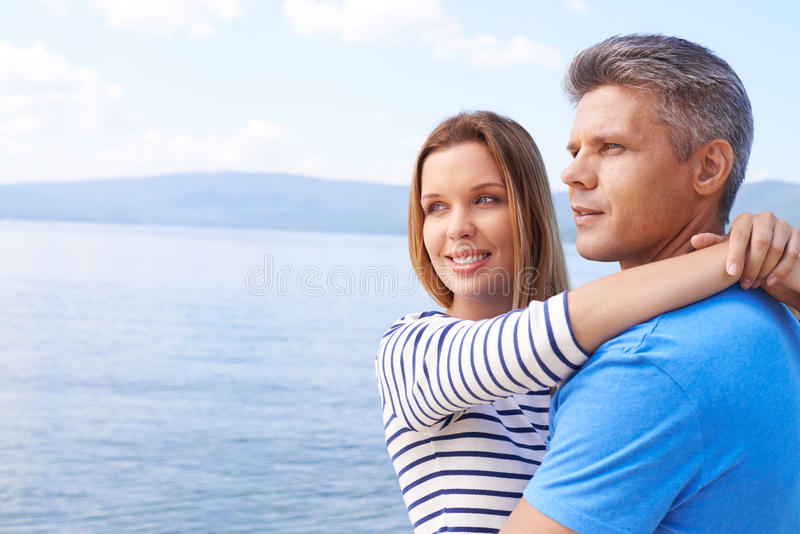 Couple on the sea royalty free stock photography
