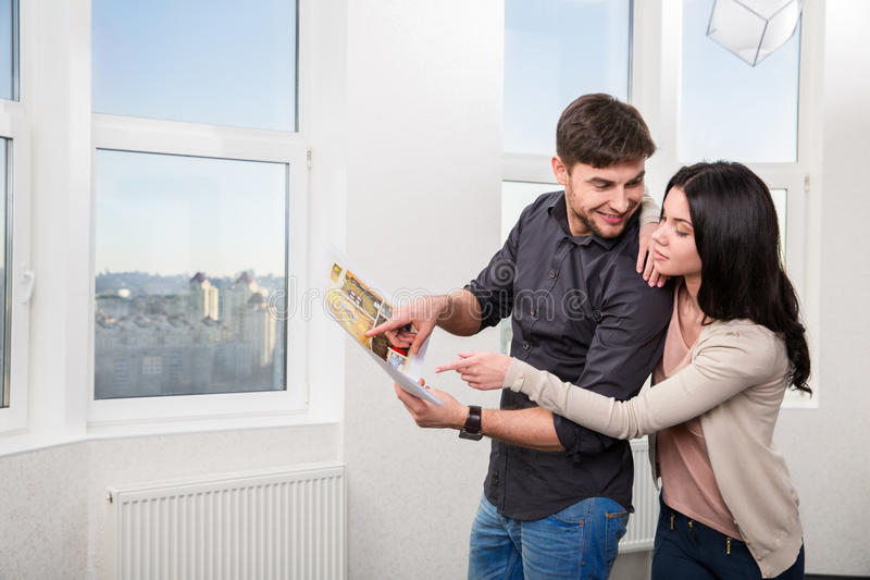 Couple in searching the real estate for a purchase. Young pair, searching the real estate for a purchase stock photo