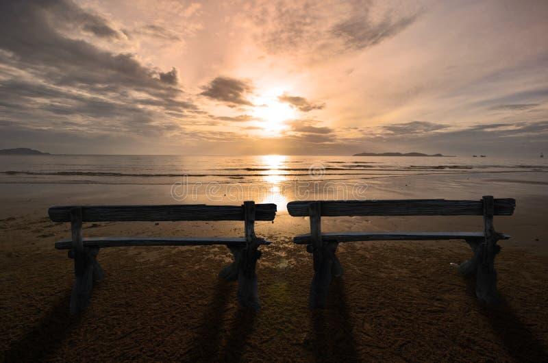 Couple seats on beautiful morning beach stock photo