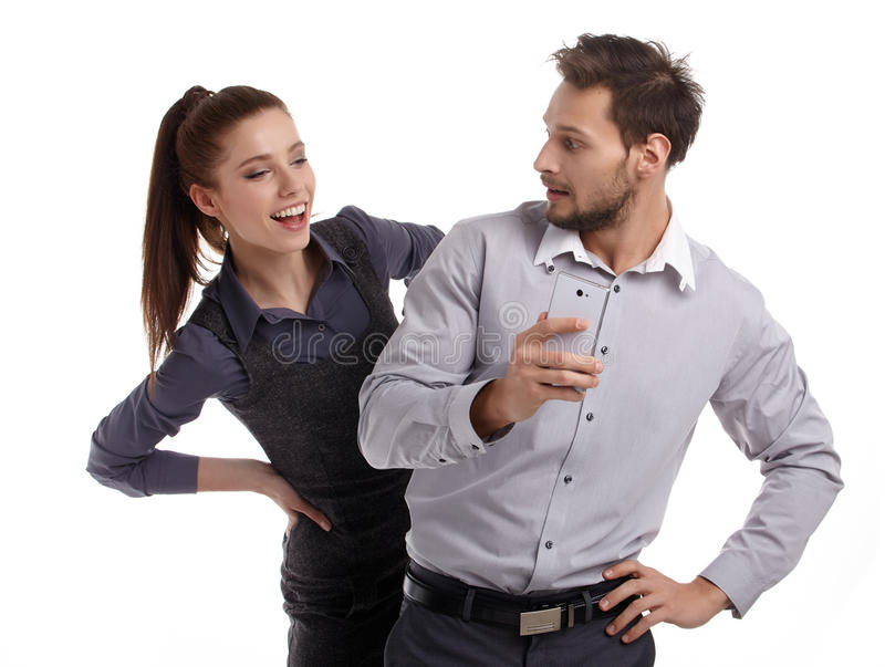 Couple and secret message on cell phone. stock image