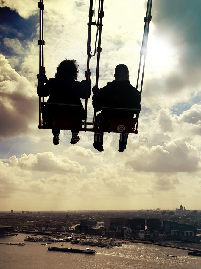 Couple on a seesaw. Inspiration, love and dreams stock image