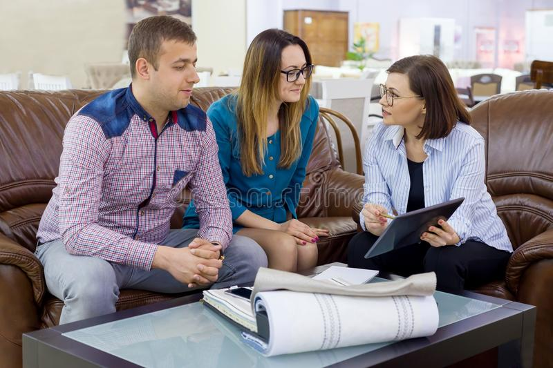 Couple selects fabrics in their new home with an interior designer. royalty free stock photo