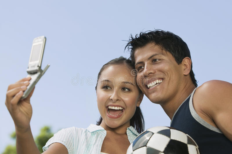 Couple Self Photographing With Cellphone stock photo