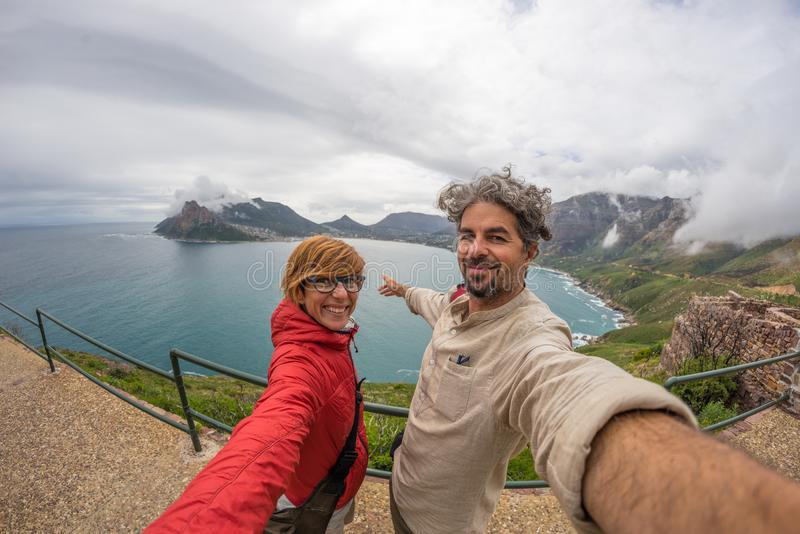 Couple selfie at Cape Point, Table Mountain National Park, scenic travel destination in South Africa. Fisheye view. stock photo