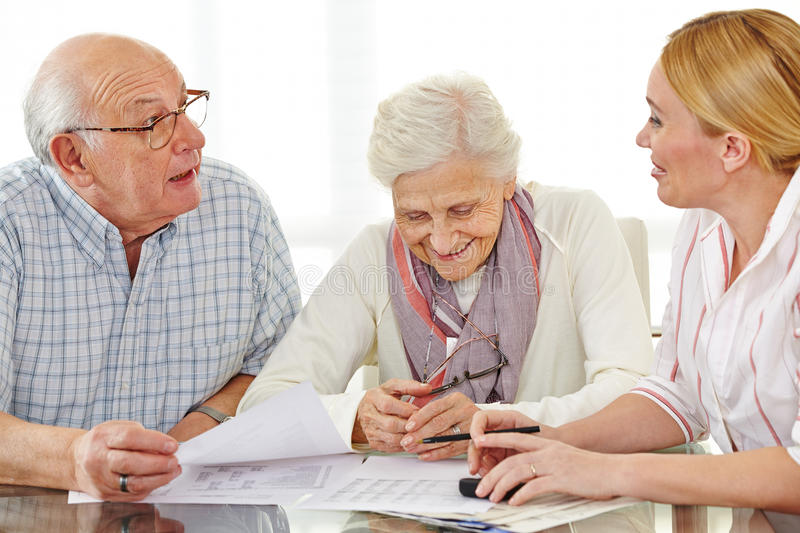 Couple of senior citizens talking. To financial consultant about their pension stock photography