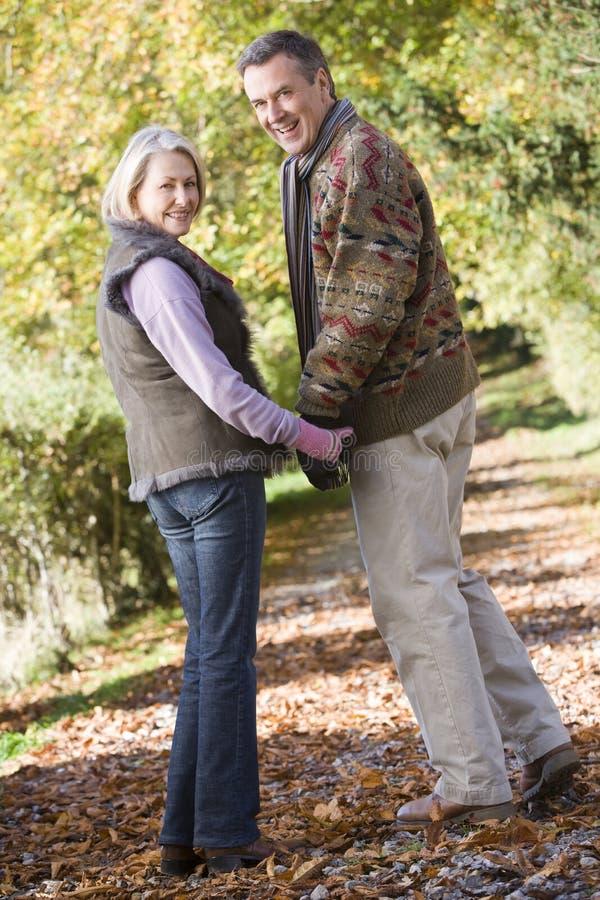 couple senior walk woodland