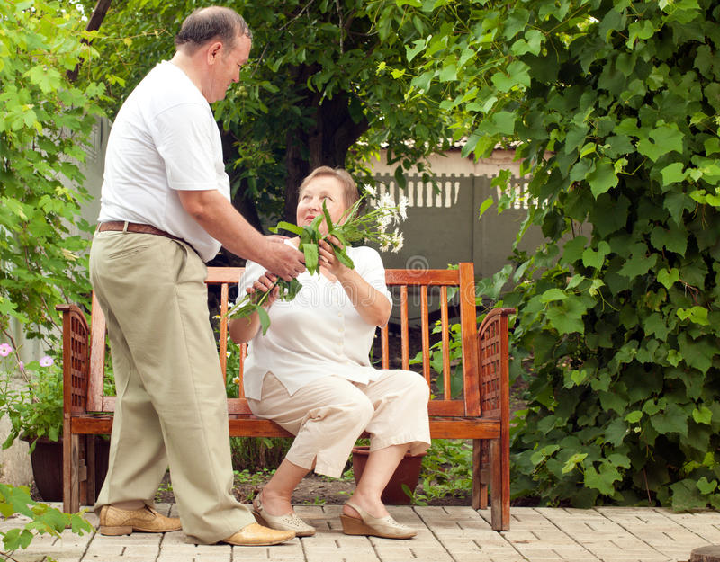 Couple seniors. In house garden royalty free stock images