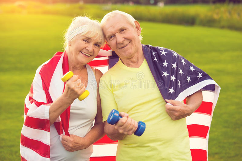 Couple of seniors with dumbbells. royalty free stock image