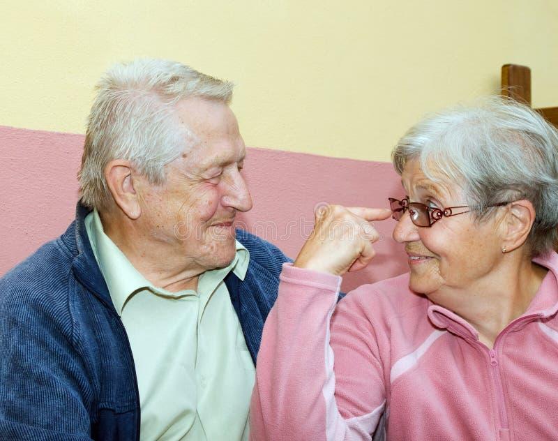 Couple of seniors having fun. Married couple of seniors having fun royalty free stock images