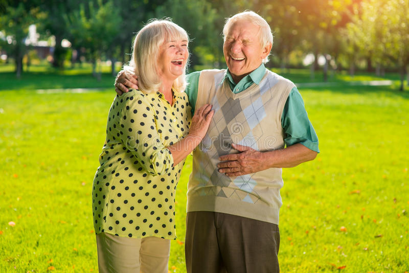 Couple of seniors laughing. stock photo