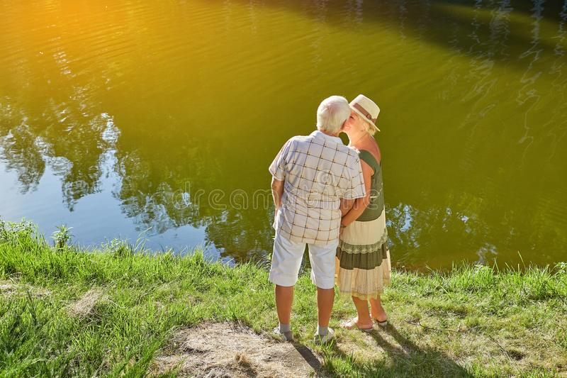 Couple of seniors near water. royalty free stock photo