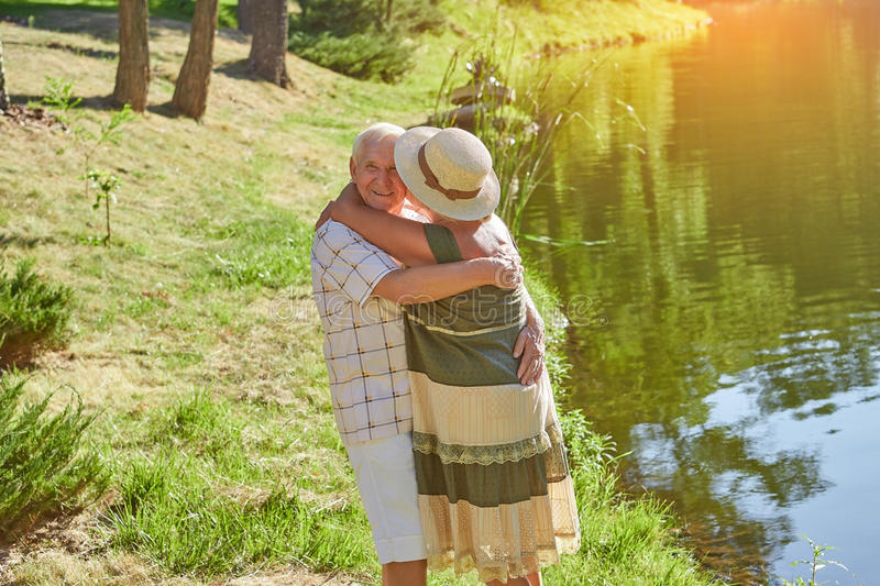Couple of seniors outdoors. royalty free stock image