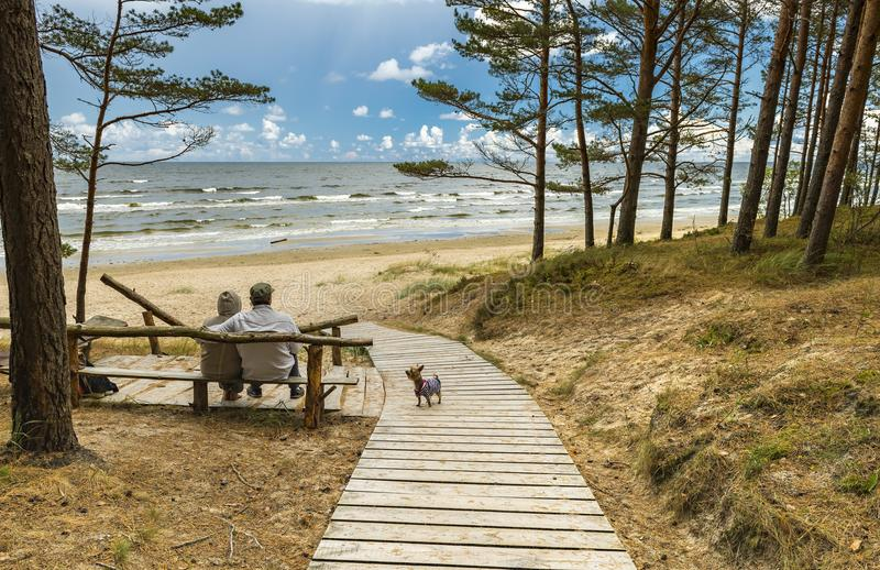 Couple of seniors are resting near a beach of the Baltic Sea stock images