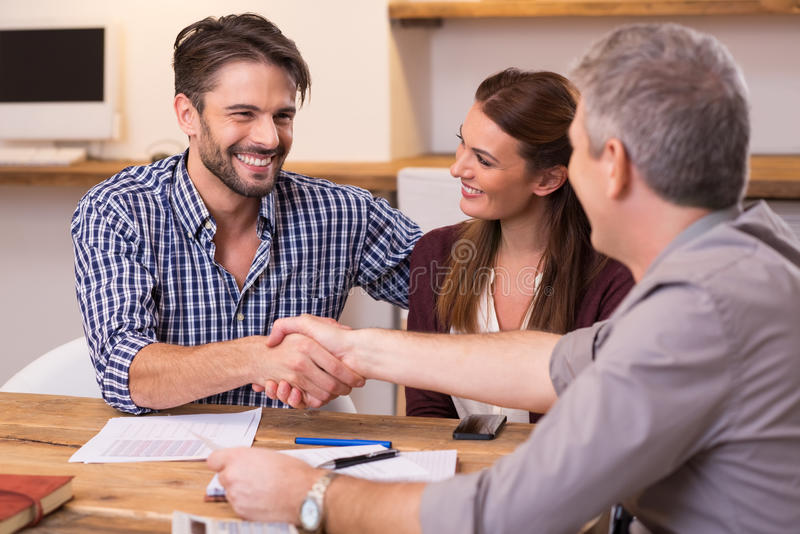 Couple shaking hand to financial agent royalty free stock images