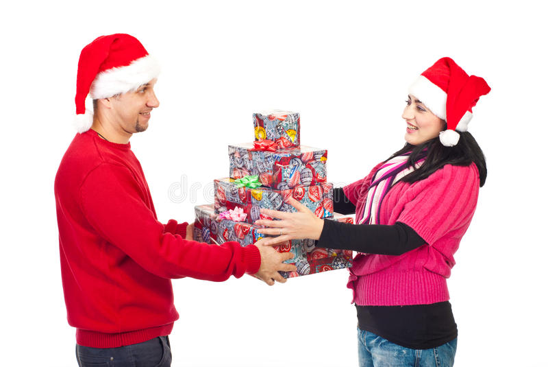 Couple sharing Christmas gifts stock photography