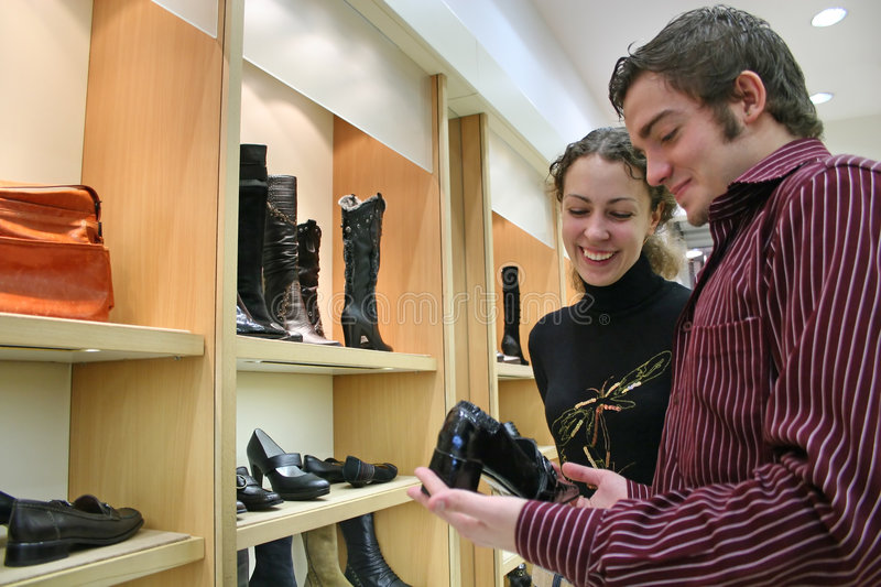 Couple In Shoes Shop Stock Image
