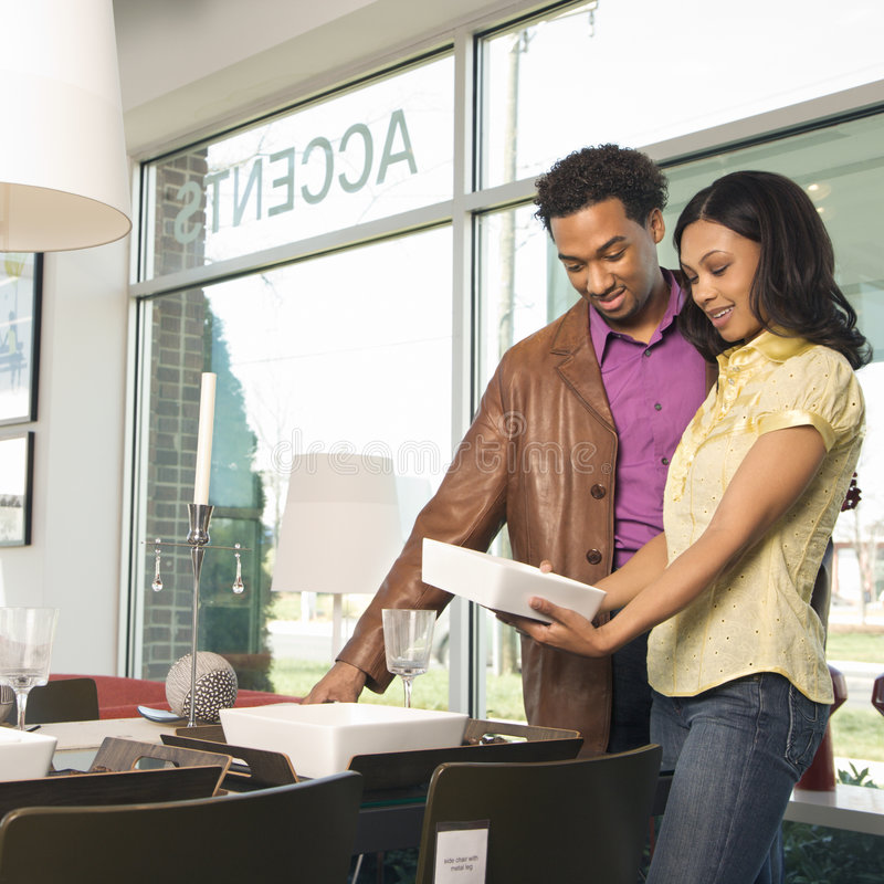 Couple shopping. African American couple shopping in retail store royalty free stock images