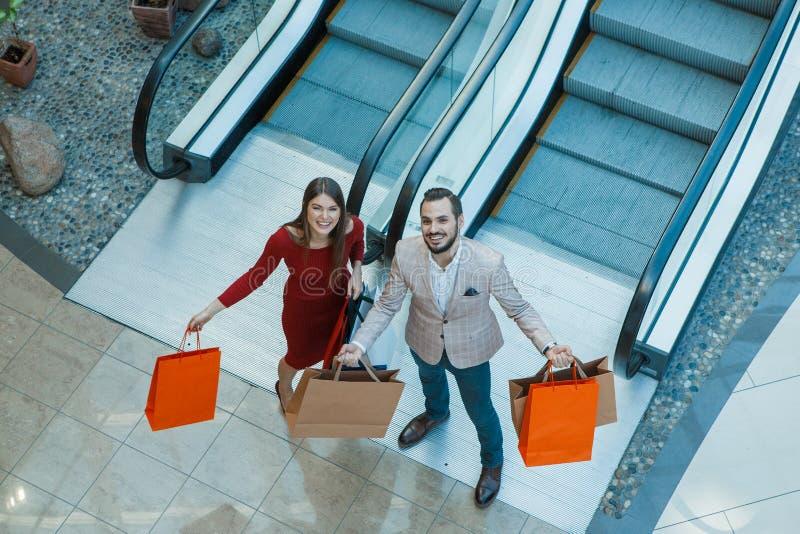 Couple with shopping bags stock photos