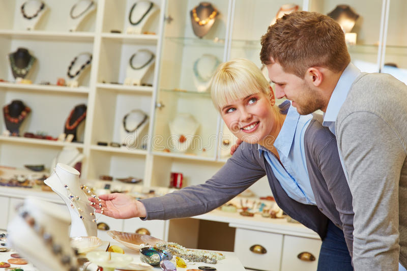 Couple shopping in jewelry shop royalty free stock images