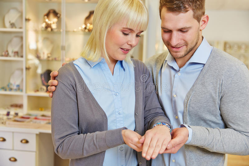 Couple shopping in jewelry store royalty free stock photos