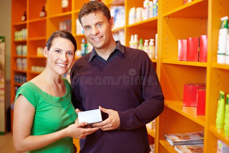 Couple Shopping For Medication Stock Photo