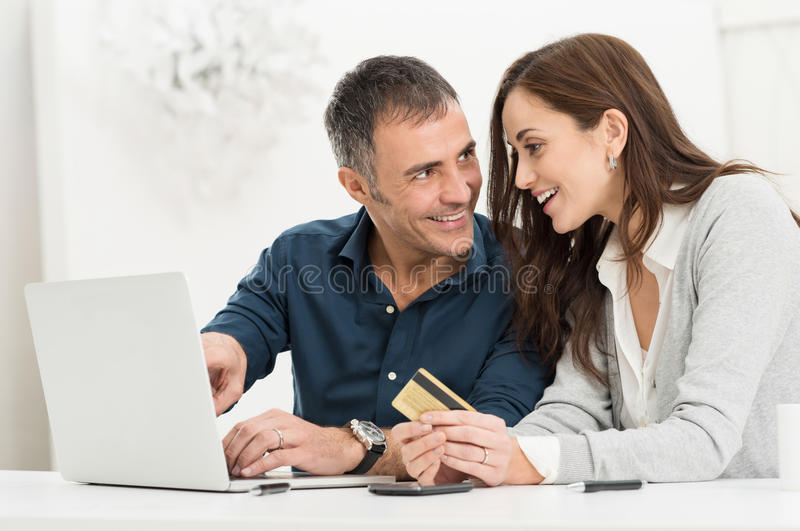Couple Shopping Online. Portrait Of Happy Couple Shopping Online Using Laptop And Credit Card