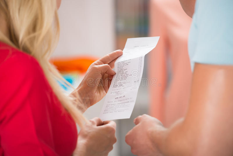 Couple With Shopping Receipt In Store stock photography