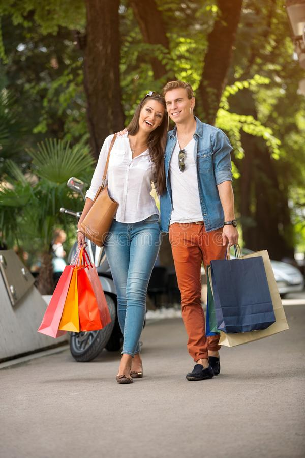 Couple shopping and spending money in city stock photos