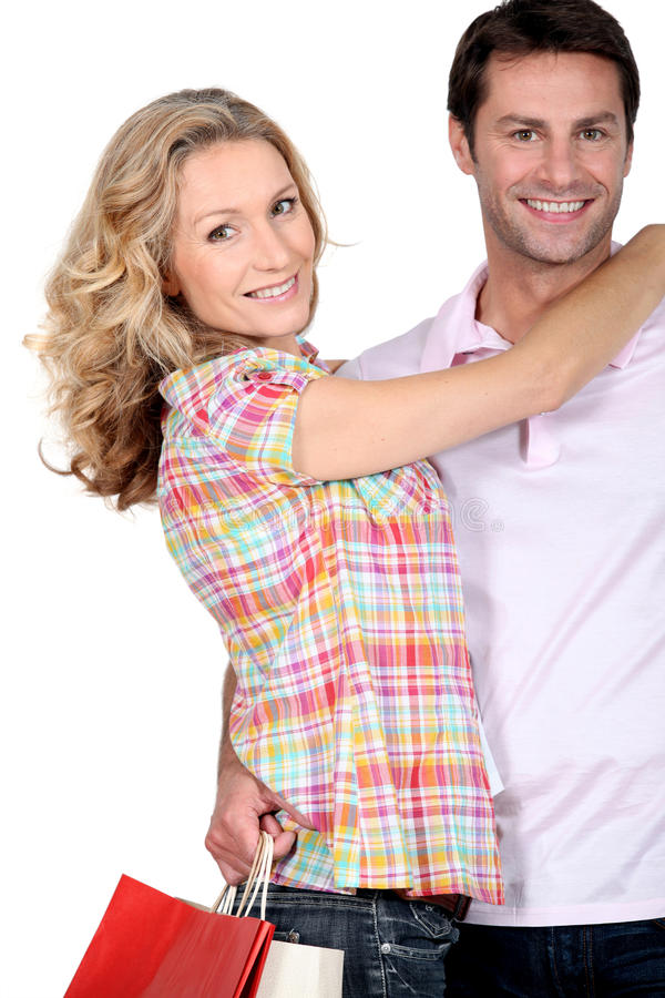 Couple on a shopping spree royalty free stock photo