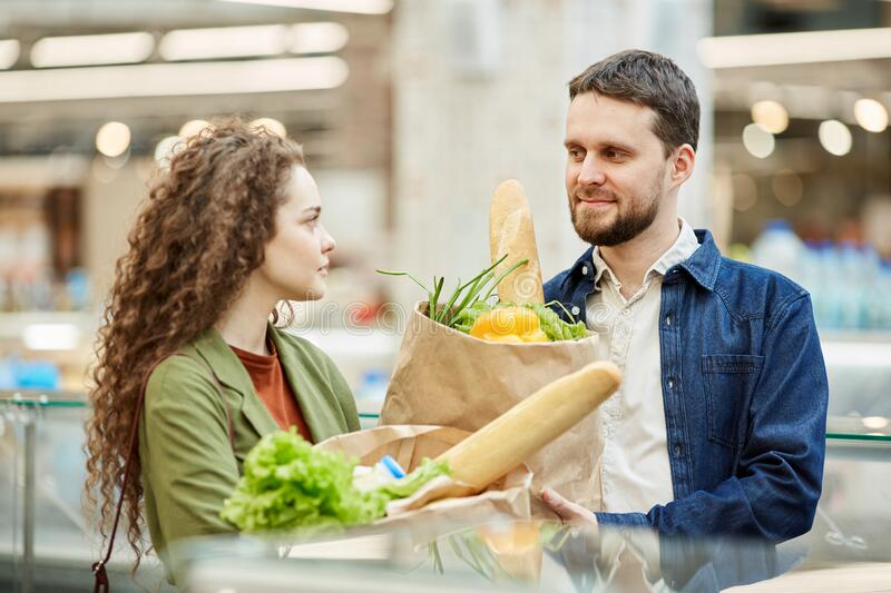 Couple Shopping in Supermarket stock images