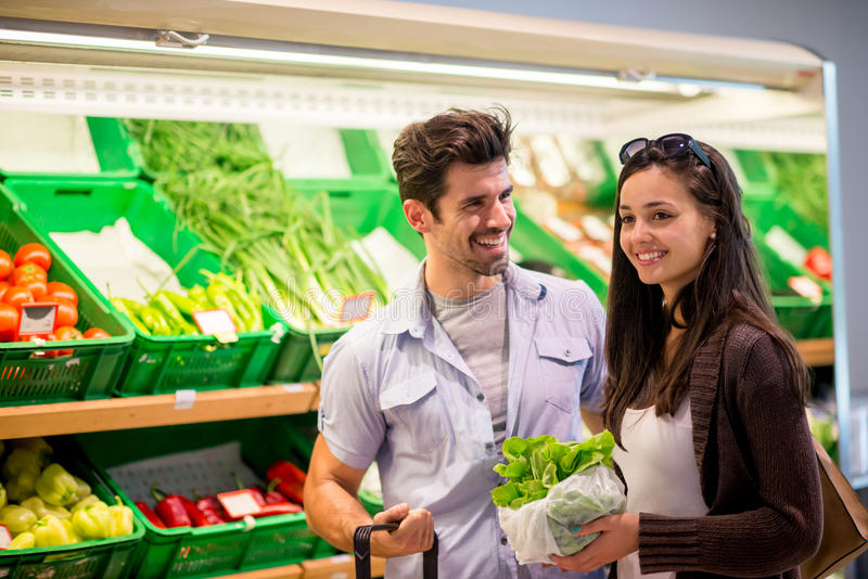 Couple shopping in a supermarket royalty free stock photo