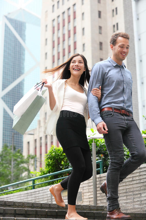 Couple shopping walking happy in Hong Kong royalty free stock images
