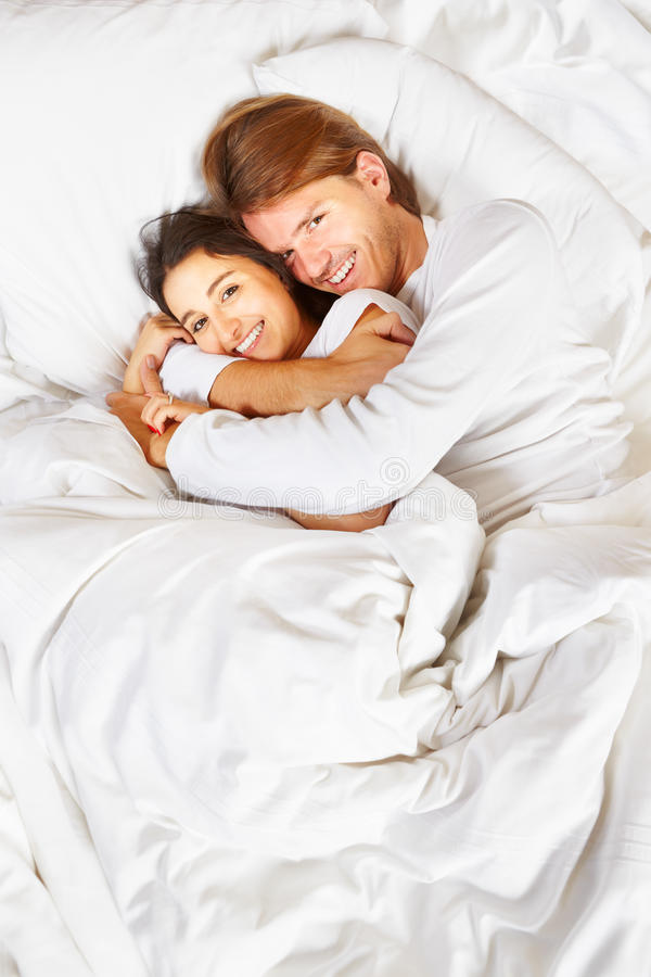 Couple showing romance on bed