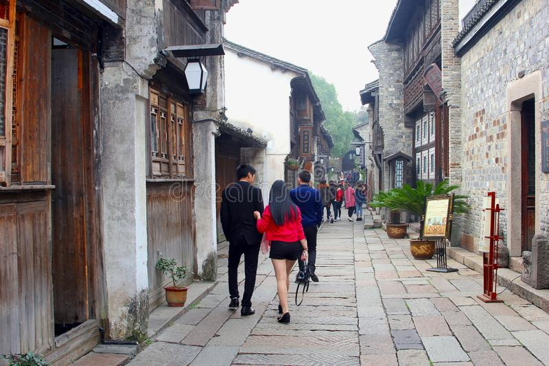 Young couple is sightseeing in ancient water town Wuzhen, China royalty free stock photo